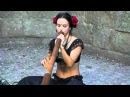Beauty playing didgeridoo in Carcassonne France
