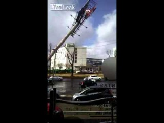 LiveLeak com   Billboard advertising falls on top of two cars during strong wind weather