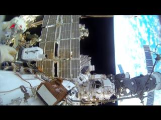 Выход в открытый космос Геннадия Падалки и Михаила Корниенко