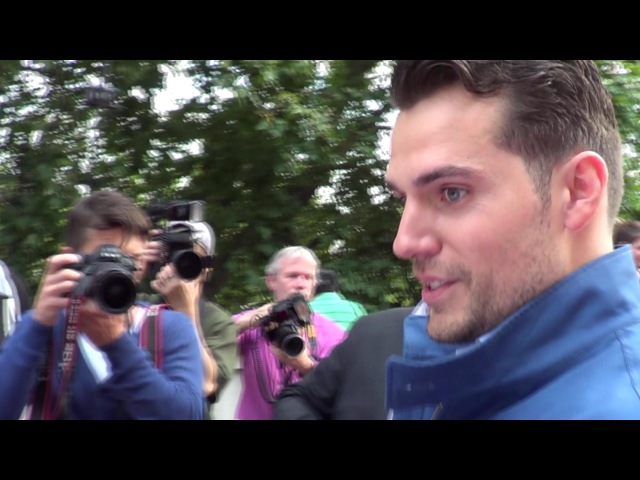 HENRY CAVILL signs Superman hat 4 children's charity 'Heroes Alliance' @ The Man from U.N.C.L.E prem