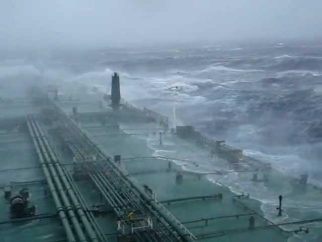 Large super tanker ship in huge storm in Atlantic