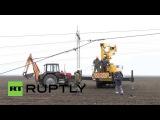 Ukraine: Work begins on restoring power lines to Crimea