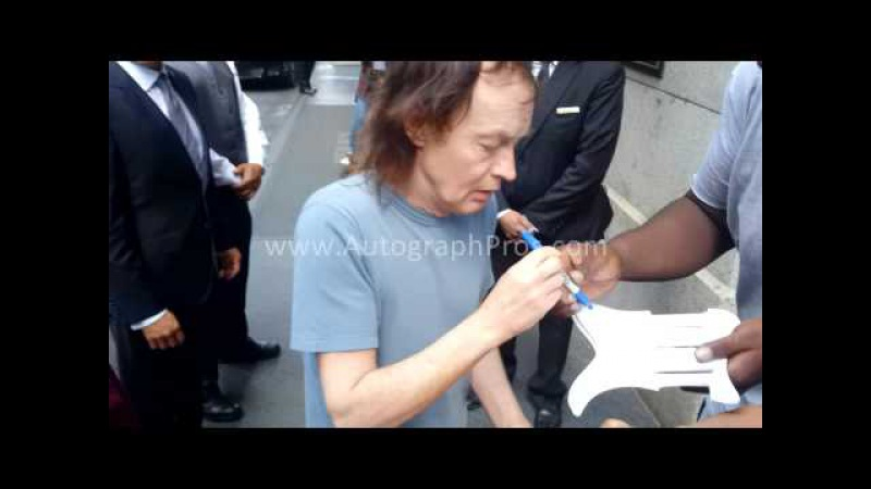 ACDC Angus Young Signing Autographed Guitar n Pickguards in NYC for AutographPros