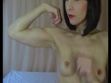 Sara flexing biceps topless
