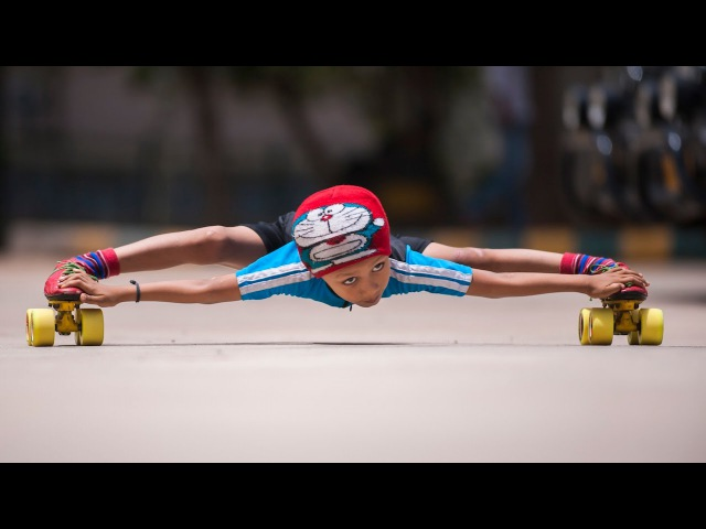 Record Breaking Limbo Skater 6 year old Skates Under 39 Cars