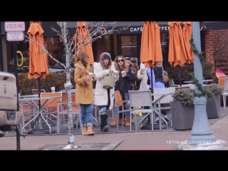 Dakota Johnson posing with fans in Aspen