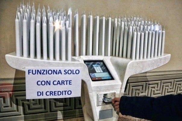 В Италии, в церкви, теперь можно зажечь временную электронную свечку кредиткой. Аминь.