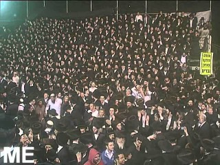 Thousands of Hasidic dancing enthusiastically in Meron