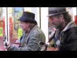 The Kinks' Dave Davies catches street busker act Laura and Pixi do Stray Cat Strut