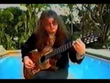 Yngwie J  Malmsteen   At Home 1 playing acoustic guitar