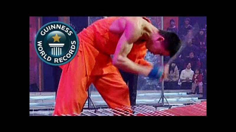 Most pig iron bars broken with the head in one minute - Guinness World Records Classics