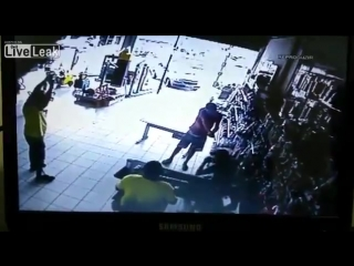 LiveLeak.com - Man Disarms ,Fights and Shoots Robber_2