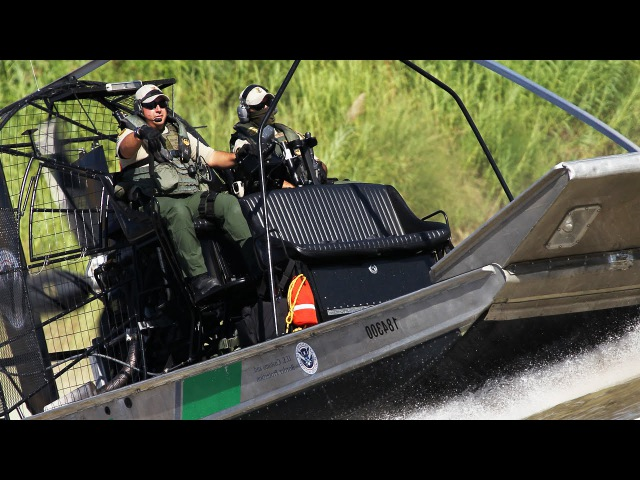 U.S CBP Men Patrolling Inside a Supercharged Engine Airboat - Customs And Border Protection Agency