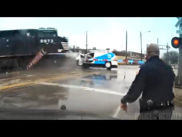 Police Dashcam Video Shows Train Smashing Into Van in Ohio