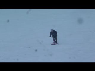 Катание на сноускуте.