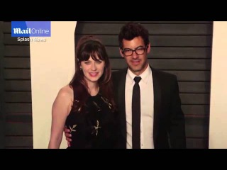 Zooey Deschanel and husband Jacob pose at Vanity Fair party