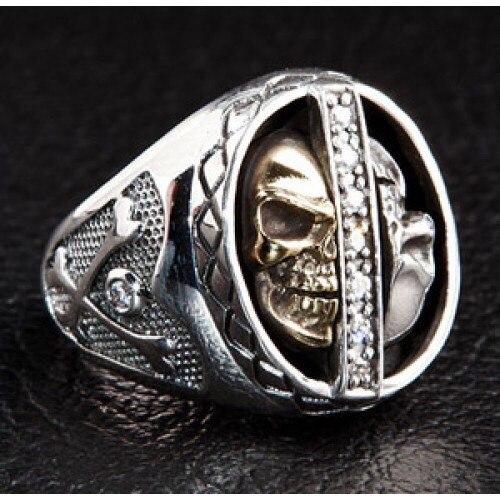 Кольца серебряные с черепом.