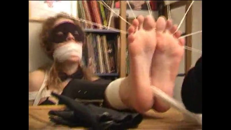 Tied toes feet in bondage video
