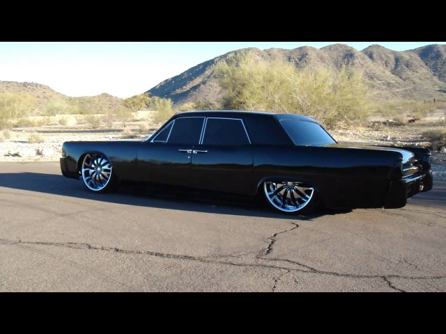 Bagged 1964 Lincoln Continental on 24 Inch Rims