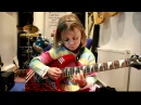 7 year old Mini Band guitarist Zoe Thomson plays Sweet Child O Mine by Gun' 'N Roses