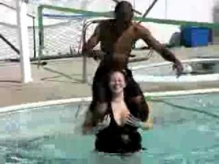 Hot sexy girl giving shulder ride in the swimming pool