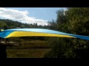 Огромный украинский флаг соединил Лисичанск и Северодонецк на взорванном сепаратистами мосту