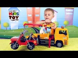 Tow truck BRUDER with a Jeep Let's open the box and tell you about a toy Educational video for kids