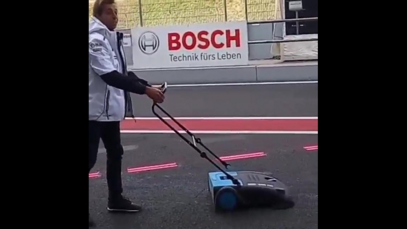 Part time job at the races... Gotta have that pitlane always clean! teamwork
