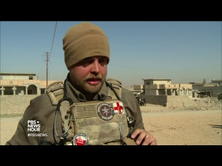 On the front lines of Mosul, 2 young American volunteers aid those injured. They treat Iraqi soldiers