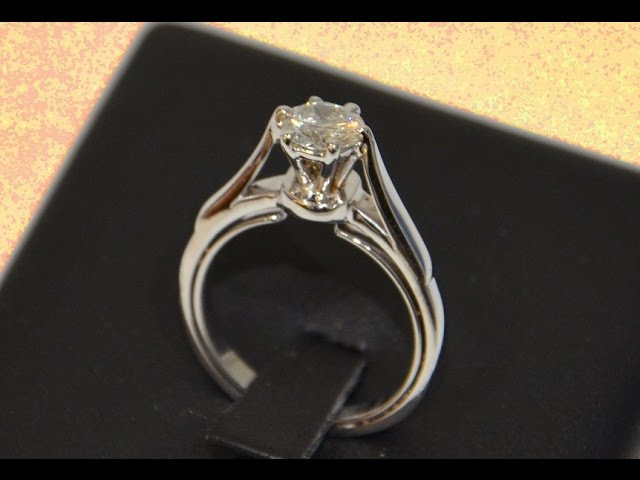 Handmade gold solitaire engagement ring six prong