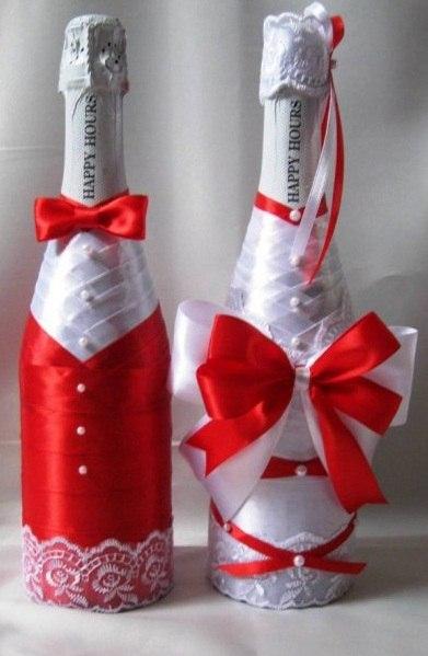 Украшение на свадьбу бутылок шампанского лентами