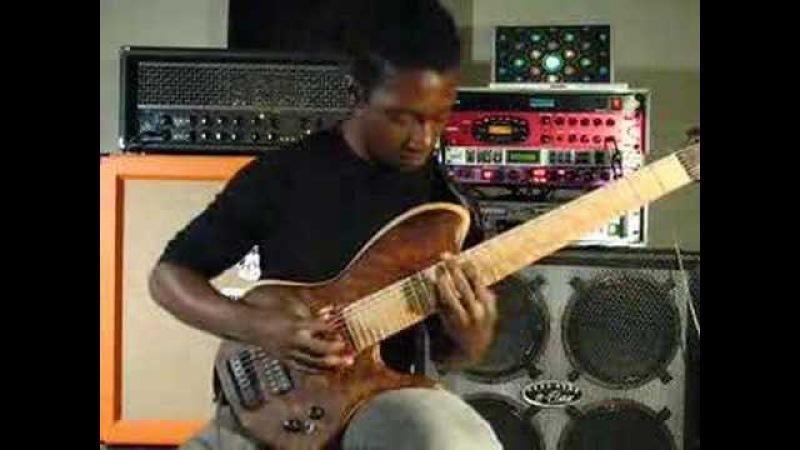Tosin Abasi playing custom 8 string guitar