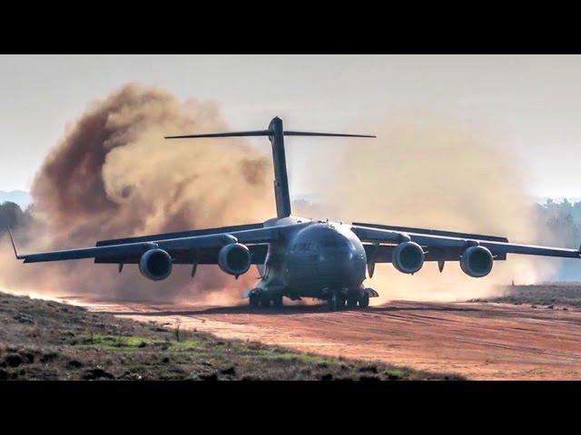 C-17 Dirt Airstrip Landing Takeoff, Unloads AH-64.
