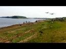 два самолета БЕ 200 набирают воду на реке Обь