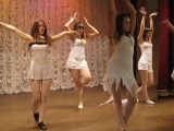 Erotic dance of young girls on the stage in the school