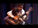 Парень с девушкой на одной гитаре )) Классно играют!!
