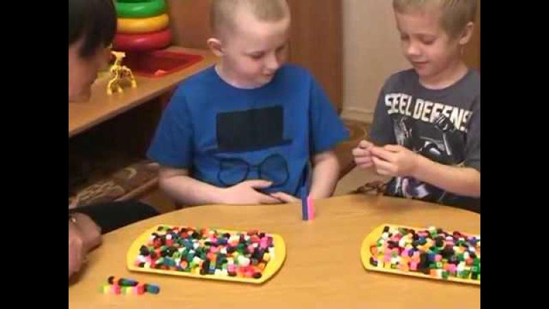 Набор счетного материала в виде соединяющихся между собой кубиков