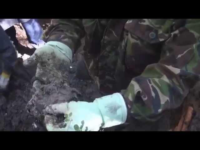 Яма с бойцами на копанном-перекопанном местеРаскопки на Карельском перешейке