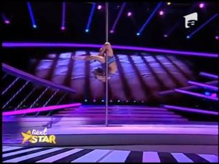 Emily moskalenko, număr spectaculos de acrobație la bară