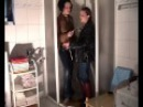 Two wetlookgirls in the shower fully clothed in jeans,boots and leather jacket during a photoshot