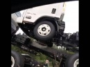 Man Yells at Truck Carrying Other Trucks