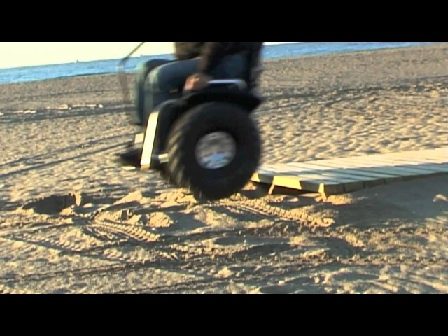 Paolo Badano Genny mobility sedia a rotelle in spiaggia Barcellona segway wheelchair