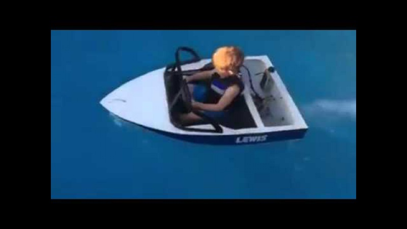 Little Dude Driving Boat in Pool
