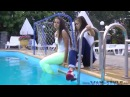 Two girls swimming fully clothed (HD)