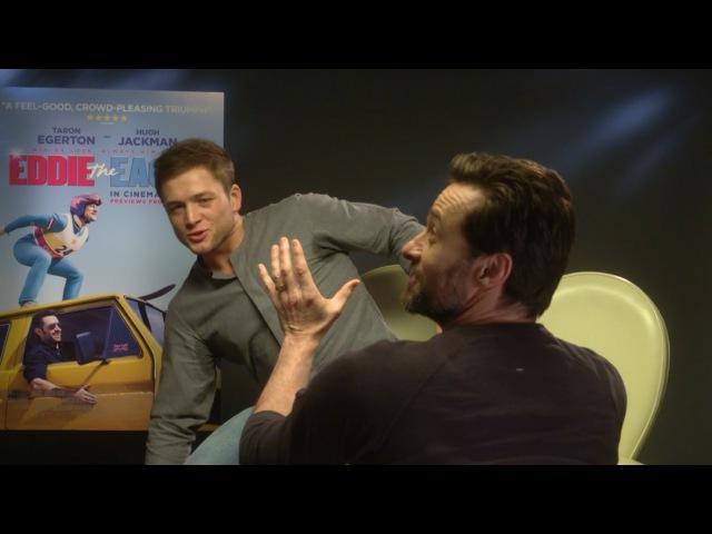 Hugh Jackman and Taron Egerton recreate the lift from Dirty Dancing!