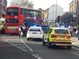 LONDONS PEOPLE TO LIFT THE BUS OFF CYCLISTS CRUSHED LEG IN Walthamstow