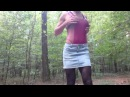 Outdoor fun in pantyhose and short skirt over latex swimsuit