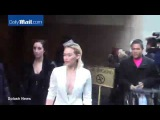 Hilary Duff takes the deep plunge in a white suit in NYC