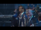 Kevin Spacey plays harmonica with Billy Joel during