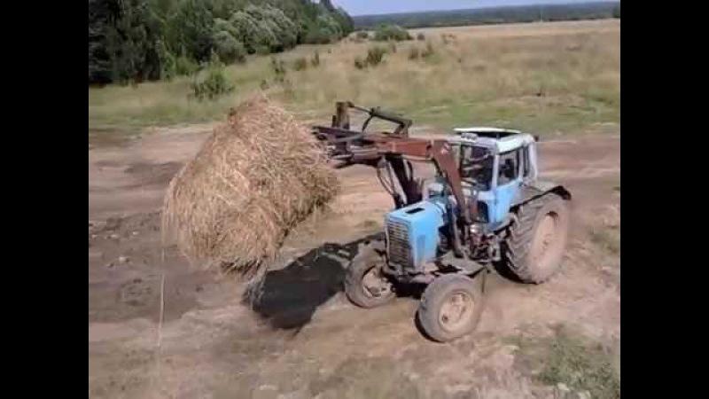 Разгружаем 2ПТС-4 с сеном